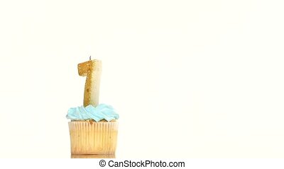 Birthday cupcake with candle number seven. - Birthday...