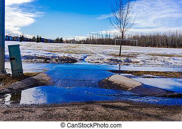 Snowmelt - snowmelt water runoff over sidewalk
