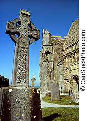 Irish celtic cross at the Cormac`s Chapel at Rock of Cashel,...