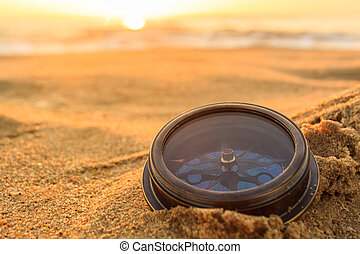 Compass - Ancient compass on the sand at the Beach Sunrise...