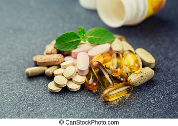 vitamins and pills - Group of different vitamins and pills,...