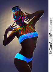 Seductive female dancer with luminous body art - Image of...