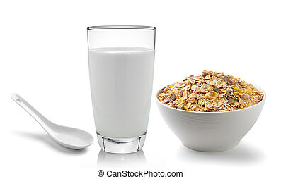 fresh milk in the glass and muesli breakfast placed on white...