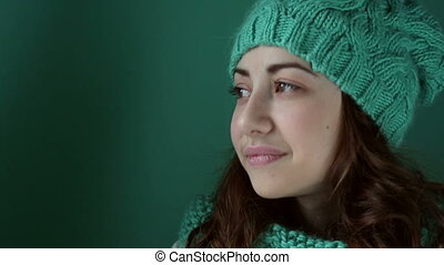 Beautiful girl nods - Beautiful girl in a turquoise knitted...