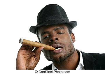 African american man smoking cigar portrait with black hat