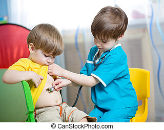 children boys play doctor together at home