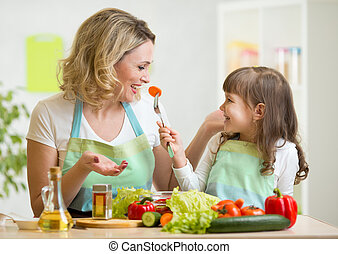 kid girl and mother eating healthy food vegetables - kid and...