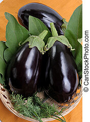 Eggplants of black colour in a basket