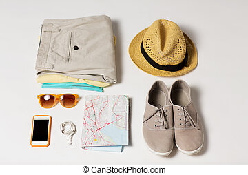 close up of summer clothes and travel map on table - summer...
