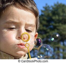 Soap bubbles - Cute boy makes soap bubbles