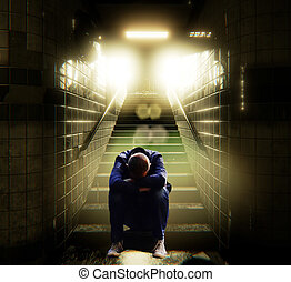 Young lonely man sleeping on steps