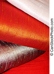 raw silk fabric - detail of folded red, grey and white raw...