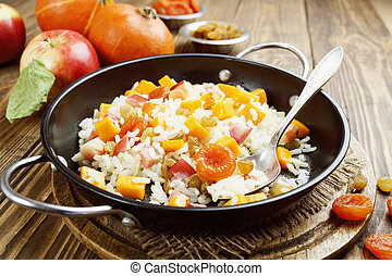 Sweet pilaf with pumpkin, apples and dried fruit on the...
