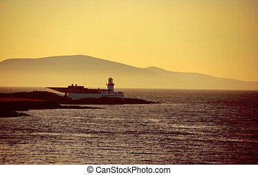 Lighthouse at sunset on Valencia Island, Western Ireland