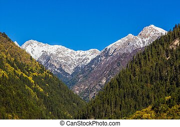 mountain snow at mirror lake Jiuzhaigou scenic area,...