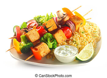 Tofu Kebabs on Flavored Rice with Mustard - Close up Gourmet...