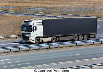 truck goes on highway - big powerful truck goes on highway