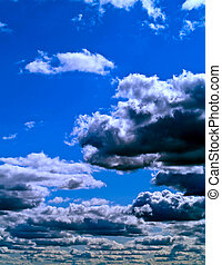 Gray Clouds on a Blue Sky - Gray and white clouds on a blue...