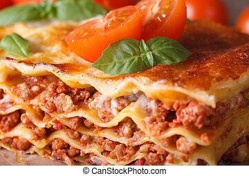 Tasty lasagna with basil and tomatoes macro horizontal -...