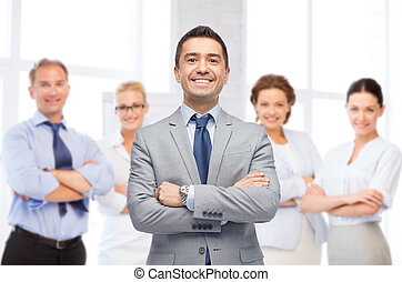 happy smiling business team over office room - business,...