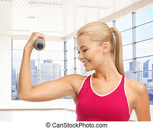 close up of sporty woman flexing her bicep - people, fitness...