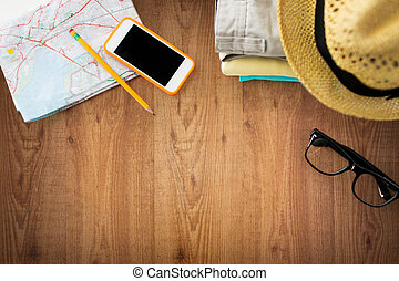 close up of summer clothes and travel map on table - travel,...