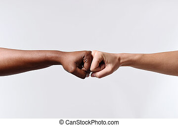 black African American race female hand touching knuckles...