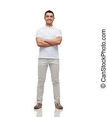 smiling man with crossed arms - happiness and people concept...