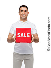 smiling man with red sale sigh - shopping, consumerism,...