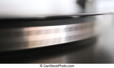 running old gramophone turntable with black disc