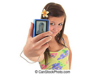 pretty teen girl taking selfies with her photo camera