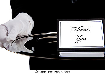 White gloved hand holding a silver tray with a thank you...