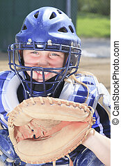 A baseball catcher at the sun light