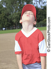 A children baseball player don't want to play