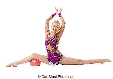 Smiling flexible girl doing split