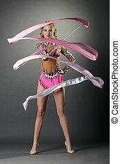 Rhythmic gymnastics. Cute girl dancing with ribbon