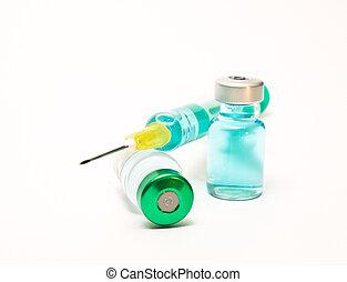 Medical syringe and phials. On white background.