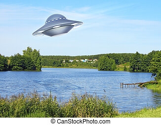 UFO flying above lake