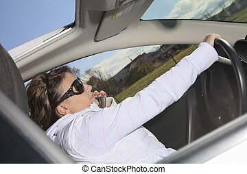 Car. Woman driver happy smiling