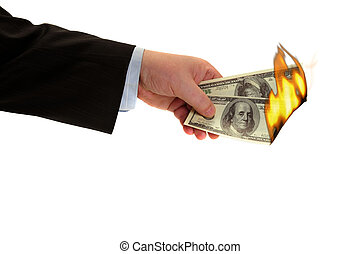 burning money - Flaming money in hand, isolated on white...