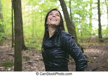 A Beautiful 30 years old woman standing in forest