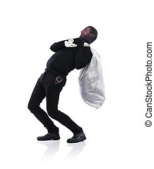 Thief in black mask - Thief in action carrying a big bag...