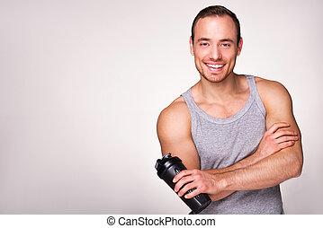 Young sporty man with sport shaker - Young sporty man...