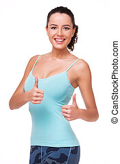 Smiling sporty woman showing thumbs up - Smiling sporty...