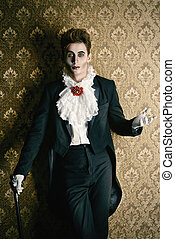tailcoat vampire - Portrait of a handsome male vampire over...