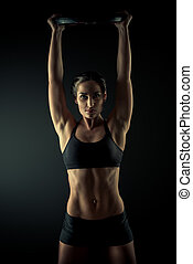 champion work - Strong young woman with beautiful athletic...
