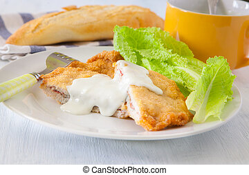 French food - french deep fried cordon bleu with salad on...