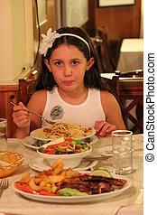 Young Girl In Restaurant, Cyprus - Girl displaying good...