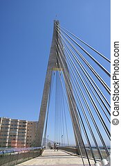 Fuengirola beach bridge - A suspended pedestrian bridge over...