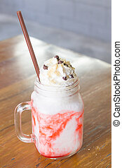 Strawberry Yogurt Smoothie  With Whipping Cream on Table